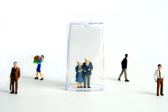 Pandemic corona virus conceptual miniature people photography – social distancing strategy - middle-aged figure on tube isolation