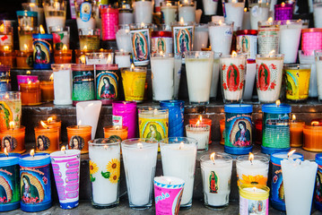 Group of colorful candles outside of a church in Mexico City, Mexico