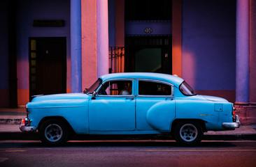 Blue car in old Havana in the evening, Cuba, Central America