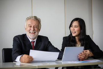 businessmen holding documents for business partners discussing  and share ideas at meeting and business women smiling happy for working