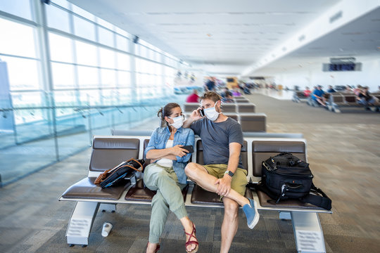 Coronavirus outbreak travel restrictions. Traveler with mask at airport affected by the travel ban and flights cancellations and border shutdowns.