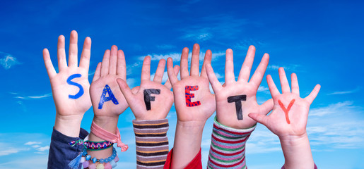 Children Hands Building Colorful Word Safety. Blue Sky As Background