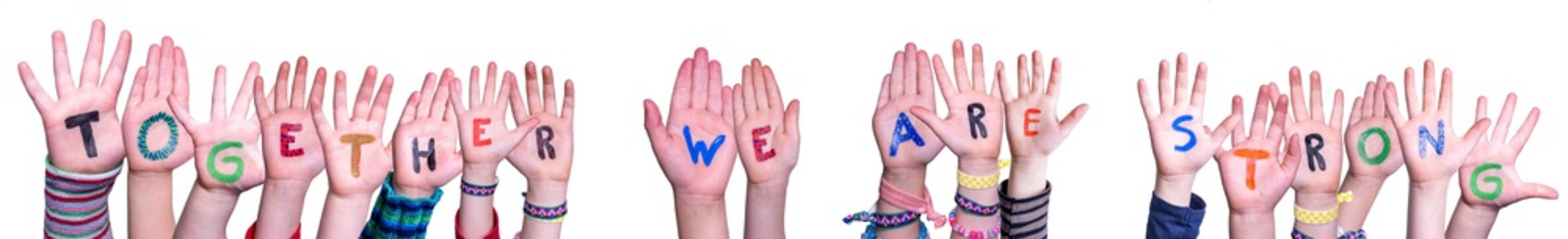 Children Hands Building Colorful Word Together We Are Strong. White Isolated Background