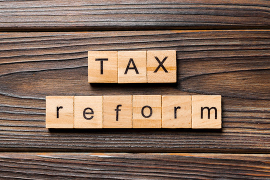 tax reform word written on wood block. tax reform text on wooden table for your desing, concept