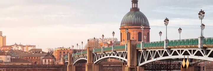 The Saint-Pierre bridge and Dome de la Grave in Toulouse, France. Pannorami view at sunrise