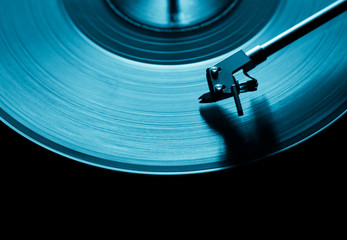 blue vinyl disc. close-up. techno music. black background.