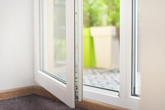 Open glass plastic white floor door to balcony terrace