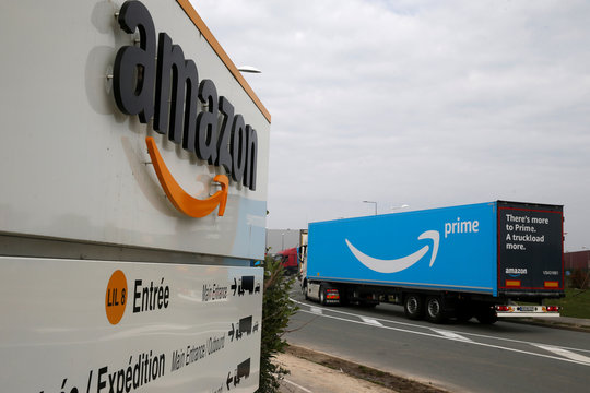 A truck with the logo of Amazon Prime Delivery arrives at the Amazon logistics center in Lauwin-Planque