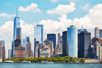 New York City skyline on a beautiful sunny day, color toning applied, USA.