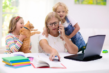 Photo sur Toile Ecole de Danse Mother working from home with kids. Quarantine.