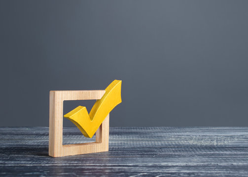 Yellow voting tick in a checkbox. Democratic institutions, vote on democratic elections, referendum. Opinion Poll. Make right choice. Confirmation, passing the test. Verification. Law implementation