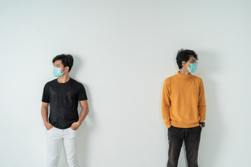 social distancing. people with masks keep their distance during virus symptoms