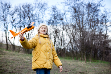 girl plays with a toy airplane