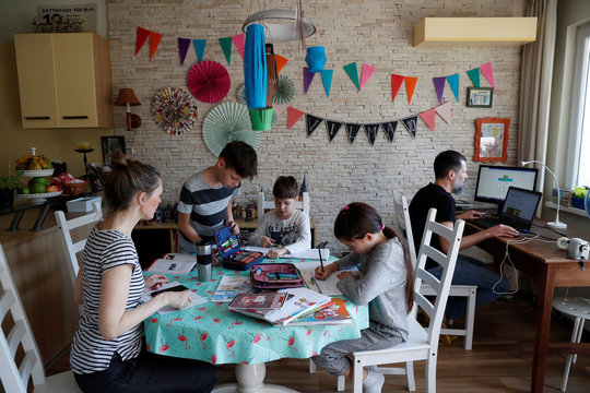 Agnes Nemes, a paper restorer working from home, studies with her children during the spread of coronavirus disease (COVID-19) in Budapest