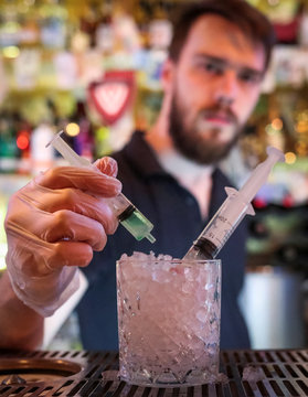 "Bartender stirs the newly invented cocktail ""Coronavirus"" in a bar in Moscow"