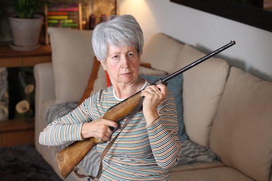 Senior woman holding a rifle