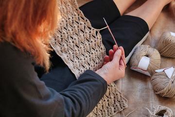 woman crocheting a natural linen pattern
