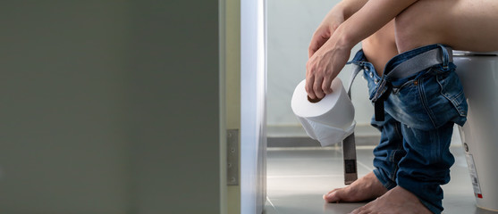 Men entering the toilet and rectal Bleeding concept, Symptom of a serious disease such as colorectal cancer, hemorrhoids and gastrointestinal bleeding