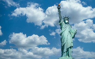 Statue of liberty wearing a surgical mask. Concept of Coronavirus, COVID-19, isolation, protection and quarantine