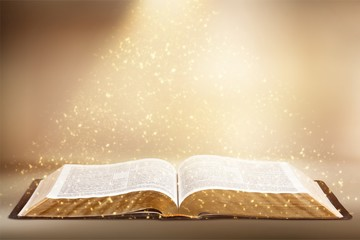 Wall Mural - Open book on desk with shine sparkles.