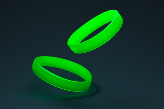 Neon Green Rubber Bracelets on Dark Background. Silicone Elastic Wrist Bands With Empty Space. 3d Rendering