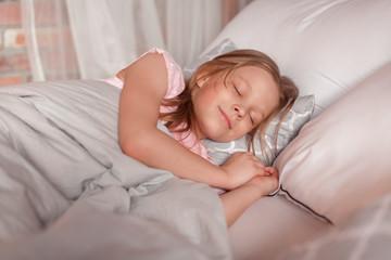 Cute  girl sleeping in bedCute  girl sleeping in bed