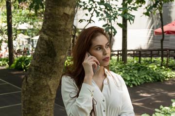 Beautiful redhead woman speaking on the phone