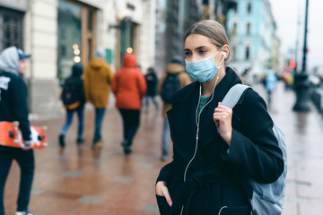 Prevention of coronavirus outbreak in 2020. Portrait of young european woman wearing a mask in the...