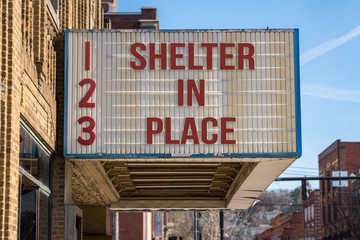 Movie cinema billboard with Shelter in Place message to avoid the coronavirus epidemic.