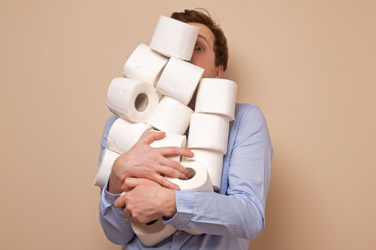 Caucasian man stocking up toilet paper at home