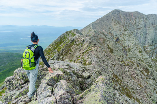 Woman hiking along Knife Edge Trail of Mount Katahdin Northeast Piscataquis Maine USA