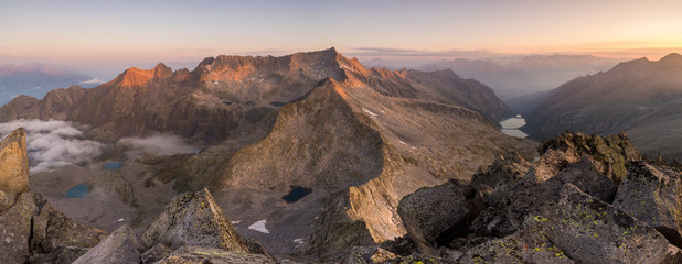 Foto op Plexiglas Cappuccino Panoramic view of Baitone peaks at sunrise in Valle Camonica, Adamello Park, Italy