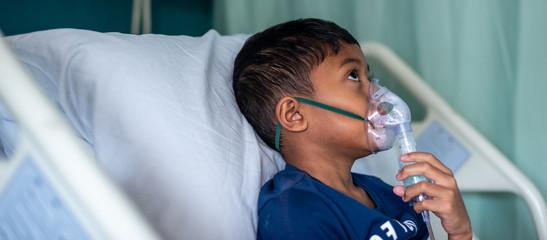 Muslim Boy with his nebuliser. Asthma treatment. Soft focus, shallow depth of field