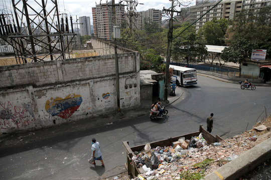 A dumpster full of garbage is seen on a street as Venezuelan utilities have hiked fees while the economy deteriorates further due to the spread of coronavirus disease (COVID-19) and the crash in global oil prices, in Caracas