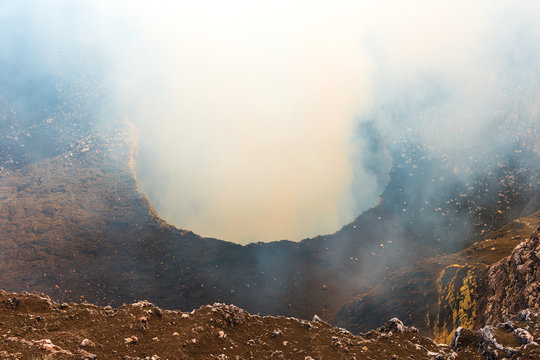 The active volcanic crater of the Masaya volcano with its gas emissions (sulfur dioxide) at sunset located between Managua and Granada, Nicaragua, Central America.