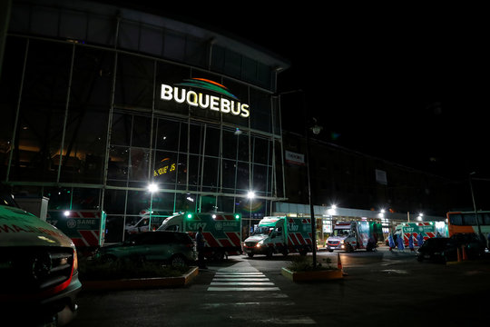 Ambulances are seen parked near the entrance of the ferry company Buquebus at the Buenos Aires docks after a passenger travelling onboard a ferry was suspected to have contracted the coronavirus disease (COVID-19), in Buenos Aires