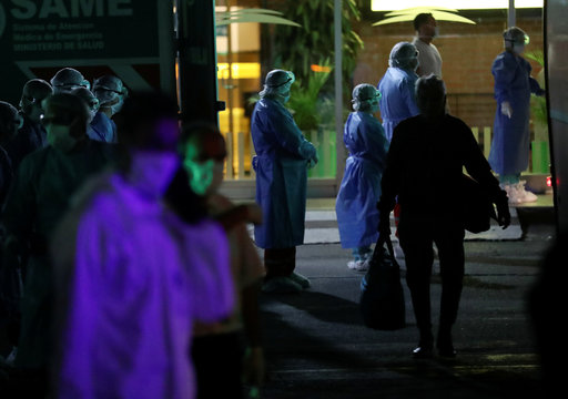 A passenger who travelled with the ferry company Buquebus walks towards a bus that will transport him and all other passengers for quarantine after one of them was suspected to have contracted the coronavirus disease (COVID-19), in Buenos Aires
