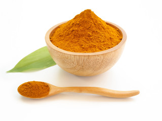 Fototapeta turmeric powder or curcuma longa in a wood bowl with green leaf and spoon use as ingredients cosmetics products and is a anti inflammatory, antioxidant, including is a herb use for health care concept obraz