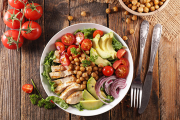 Wall Mural - vegetable salad with chicken, chickpea, avocado,tomato and onion