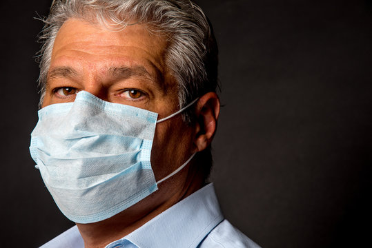 Face of a man wearing a surgical mask