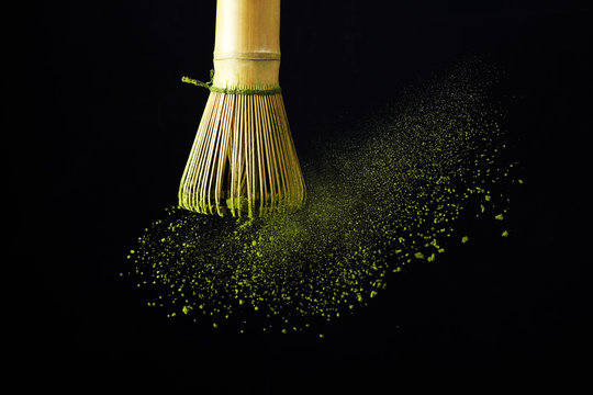 Japanese matcha green tea for healthy lifestyle design. Organic green tea matcha powder splash.