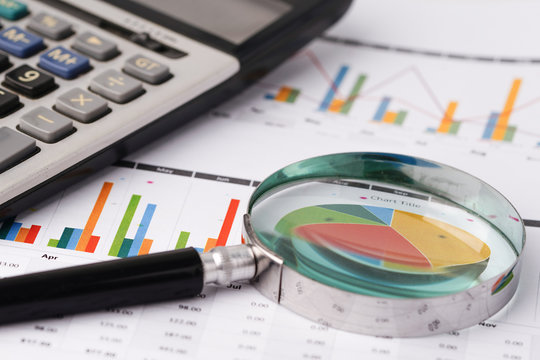 Magnifying glass on charts graphs paper. Financial development, Banking Account, Statistics, Investment Analytic research data economy, Stock exchange trading, Business office company meeting concept.