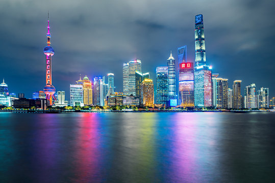 Shanghai, China - Nov. 28, 2019: Skyline view from Bund waterfront on Pudong New Area at blue hour