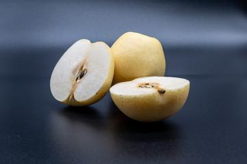 pyrus pyrifolia - fresh asian pear  isolated on black background