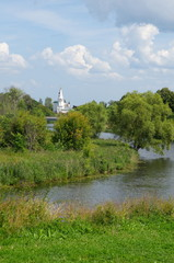 Poster Channel Kamenka river and the Church of St. Nicholas on a Sunny summer day. Suzdal, Vladimir region. Golden ring of Russia