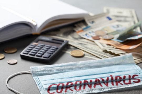 Medical face mask, notebook and money, world coronavirus epidemic and economic damages. Corona virus concept.