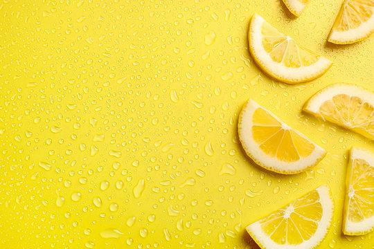 Lemon slices on yellow background