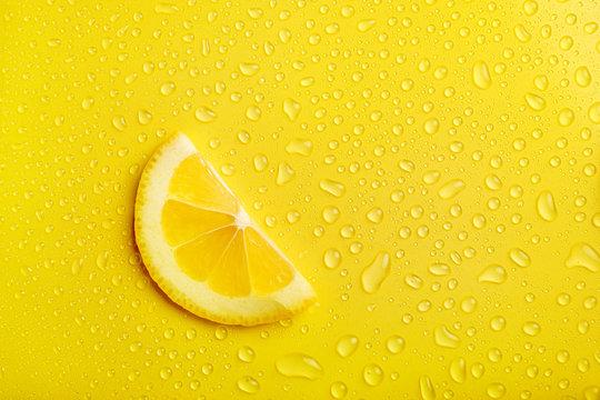 Lemon slice on yellow background