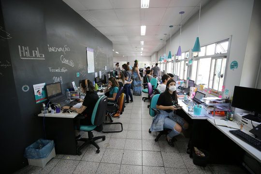 Employees of Brazilian health equipment startup Hi Technologies, work in a batch of tests to diagnose the coronavirus disease (COVID-19), at their office in Curitiba