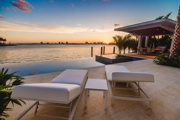 Sunset scene by the infinity and a beauty view of the bay in Miami